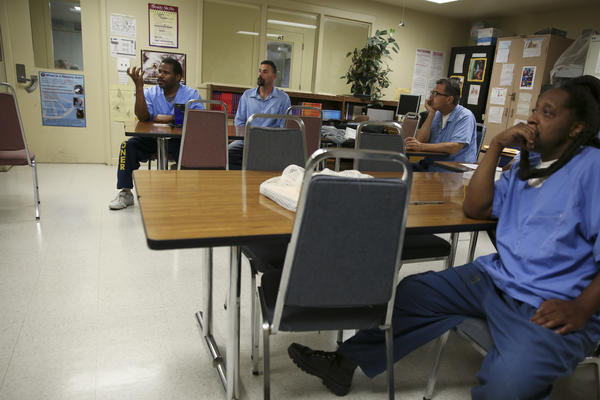 Student-inmates discuss realms of consciousness in an introduction to philosophy class.