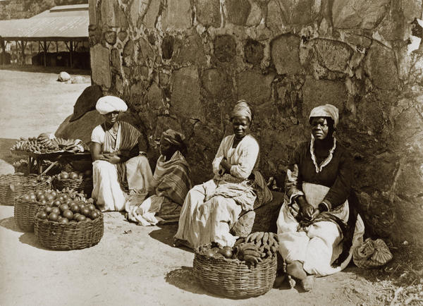 "A photo from 1875 in Rio de Janeiro shows women street sellers called ""<em>quitandeiras,</em>"" also known as ""slaves who earn."" A portion of the profits was returned to their masters."
