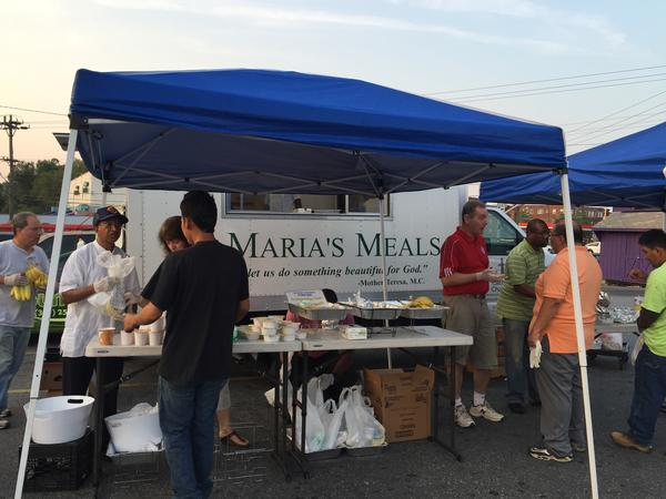 The St. Maria's Meals food truck stops every Friday morning at a parking lot in Langley Park, Md. There, volunteers hand out breakfast to day laborers waiting in the parking lot for work.