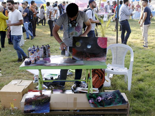 A man paints at the City of Peace Carnival. The event has grown over the last five years to include 500 volunteers, corporate sponsorship and many acts.