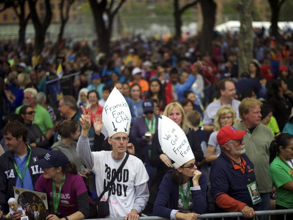 People gather on the Benjamin Franklin Parkway for the papal Mass on the final day events with Pope Francis in Philadelphia, on Sunday. After six days in the U.S., Francis returns to Rome Sunday evening.
