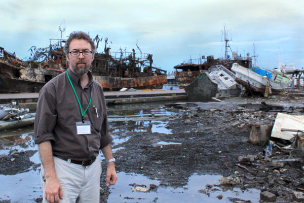 <p>Jay Wilson, Oregon Seismic Commission Chair, surveys tsunami damage on a 2011 visit to Japan.</p>