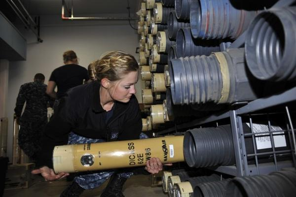 <p>Sailor Renee Duhaime places a sonobuoy onto a storeroom rack. The Navy wants to deploy 700 of these sub-hunting devices in the waters of the Pacific off the coastline of Washington and Oregon.</p>