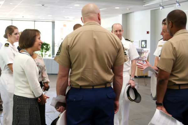 UNC-Chapel Hill Chancellor Carol Folt (second from left) meets with service members May 20, after announcing two new university programs to serve current and former military personnel.