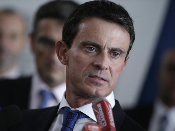 French Prime Minister Manuel Valls speaks to the media Tuesday at the Air France headquarters in Roissy-en-France.