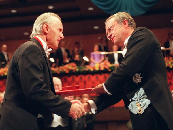 Harold W. Kroto (left) receives the Nobel Prize in chemistry from Swedish King Carl XVI Gustaf in Stockholm, in 1996.