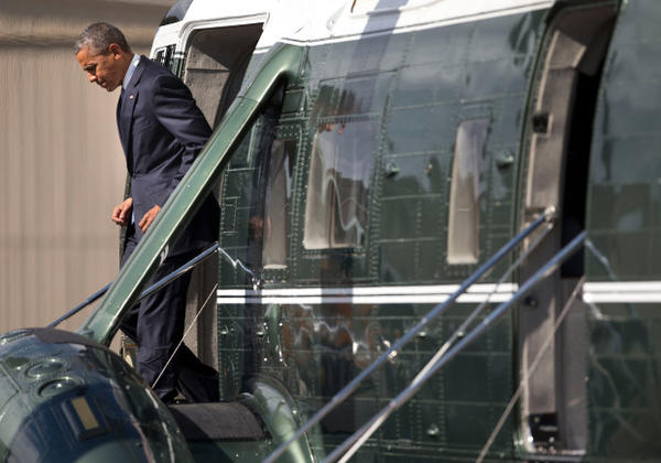 <p>President Barack Obama steps off Marine One upon his arrival at Roseburg Municipal Airport, Friday, Oct. 9, 2015 in Roseburg, Ore. Obama traveled to Roseburg, to meet with families of the victims of the Oct. 1, shooting at Umpqua Community College, as part of a four-day West Coast tour. Obama is also scheduled to attend a fundraiser event later today in Seattle with Sen. Patty Murray, D-Wash. He's is also attending fundraisers in San Francisco and Los Angeles during the four-day visit. </p>