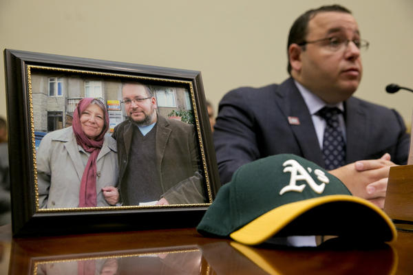 Ali Rezaian, brother of imprisoned Washington Post journalist Jason Rezaian, speaks by a picture of Jason and his mother on June 2, 2015. A verdict has been reached in Jason Rezaian's case, an Iranian official says, but it's not clear what the verdict is.