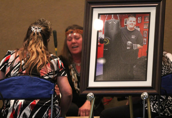 Members of a drum circle commemorate the life of Quinn Cooper during a memorial service for him at Roseburg Christian Fellowship church in Roseburg, Ore. on Saturday Oct. 10, 2015.