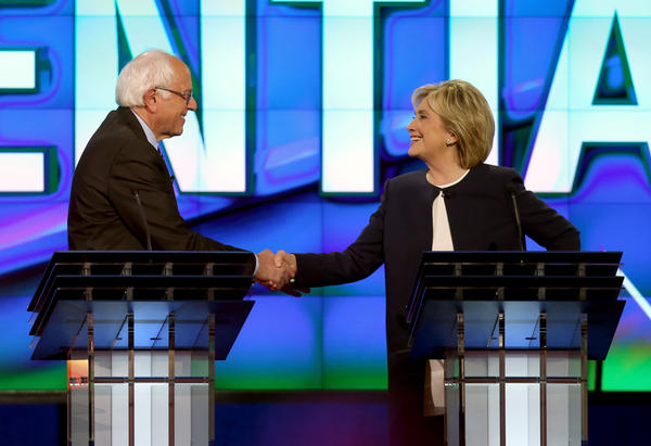 Democratic presidential candidates U.S. Sen. Bernie Sanders (I-VT) (L) and Hillary Clinton shake hands at the end of a presidential debate sponsored by CNN and Facebook at Wynn Las Vegas on October 13, 2015 in Las Vegas, Nevada. Five Democratic presidential candidates participated in the party's first presidential debate.  (Joe Raedle/Getty Images)