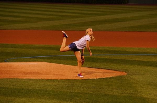 Katie Russell throwing out the first pitch at Wrigley Field on the last stop of her tour of every MLB stadium in a single season.