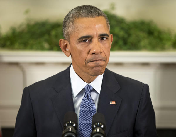 President Obama pauses as he speaks about Afghanistan on Thursday in the Roosevelt Room of the White House.