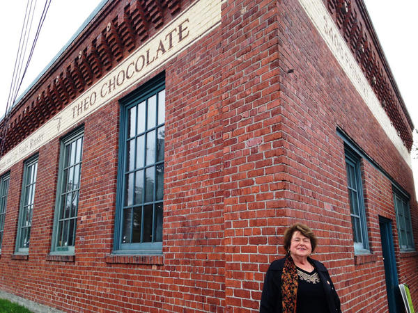 Landlord Suzie Burke poses outside the Theo Chocolate warehouse in Seattle's Fremont neighborhood. Burke's company contributed $45,000 to Tim Eyman's latest tax limiting initiative.