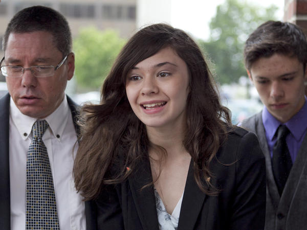 Transgender student Nicole Maines (accompanied by her father, Wayne, and her twin brother, Jonas) speaks to reporters after winning on appeal a discrimination lawsuit against her school district. In 2014, <em>Glamour </em>magazine named Maines one of its 50 inspiring women of the year.
