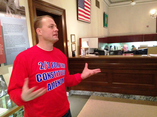 File photo of anti-tax activist Tim Eyman. The latest Elway Poll shows Eyman's tax-limiting measure on Washington's November ballot is tied.