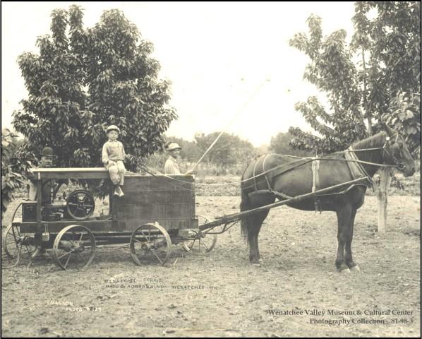 <p>A Wenatchee Sprayer made by A. D. Browning, Wenatchee. Two men, one with bamboo spray pole, and one small boy sitting on top of sprayer pulled by one horse in a fruit orchard in Wenatchee. Because farmers did not know of the potential toxicity or longevity of pesticides in use at the time, Washington law exempts farmers from being liable for contamination from legally applied pesticides.</p>