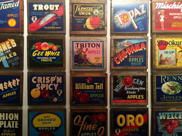 <p>Old Central Washington apple labels hang in the Wenatchee Valley Museum & Cultural Center. The Apple industry is a crucial part of life in Central and Eastern Washington, and many feared an overreaction to lead and arsenic contamination would hurt apple growers.</p>