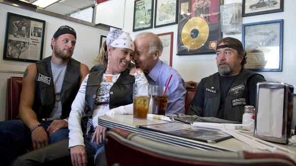 Vice President Biden talks to a woman in biker gear, who's sitting on a chair in front of him at a diner in Ohio in September 2012. She's not sitting on his lap, but it sure looks like it.