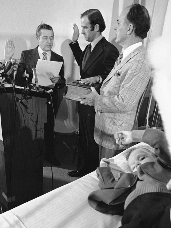 Joe Biden takes the oath of office in 1973 for the U.S. Senate in his sons' hospital room following a car crash that killed his wife and daughter. In the foreground, is his then-4-year-old son Beau.