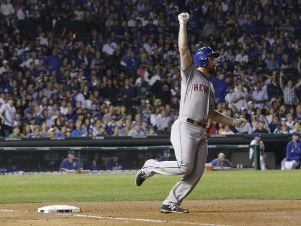 New York Mets' Daniel Murphy rounds first after hitting a two-run homer in the eighth inning of Game 4 of the National League championship series against the Chicago Cubs.