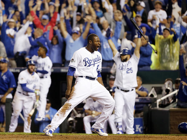 The Royals' Lorenzo Cain celebrates after scoring on a hit by Eric Hosmer in the eighth inning against the Blue Jays in Game 6 of baseball's American League Championship Series.