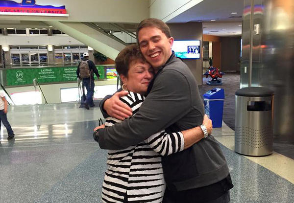 Former Private First Class Andrew is welcomed home by his grandmother Wanda Yarbrough Sunday at the Boise airport after serving time in an Army prison for war crimes.
