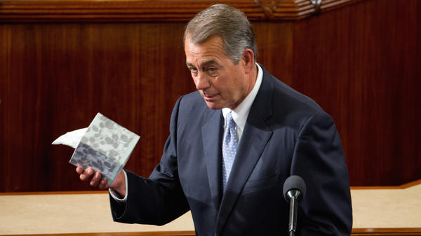 Boehner of Ohio held up a box of tissues as he prepared to speak Thursday.