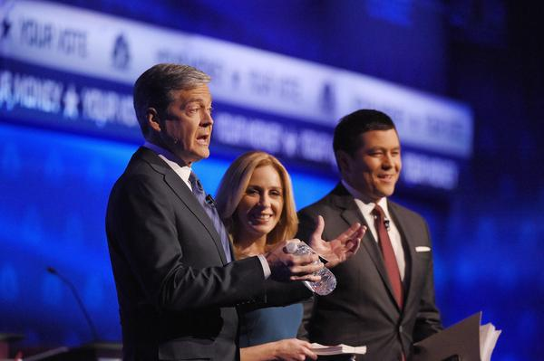 Debate moderators John Harwood, left, Becky Quick, center, and Carl Quintanilla take the stage during the CNBC Republican presidential debate at the University of Colorado on Wednesday.