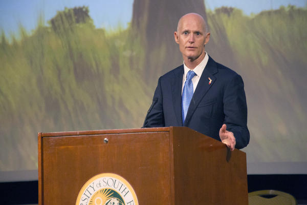 Florida Gov. Rick Scott speaks at the 2015 Human Trafficking Summit at the University of South Florida.