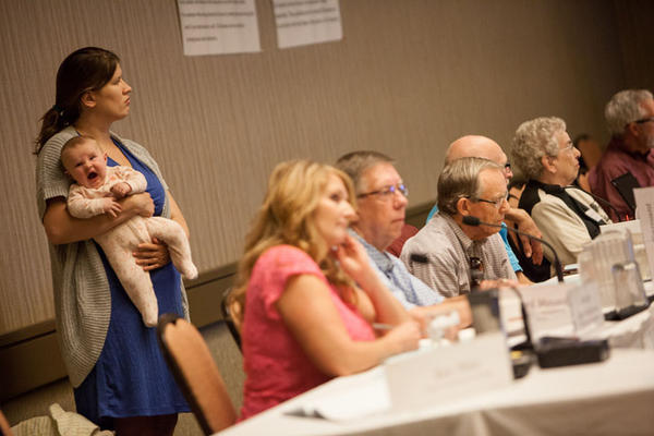 Liz Mattson holds three-month-old Mazey during a Hanford Advisory Board meeting on September 5, 2014. It was Mattson's first return to the HAB after having Mazey.