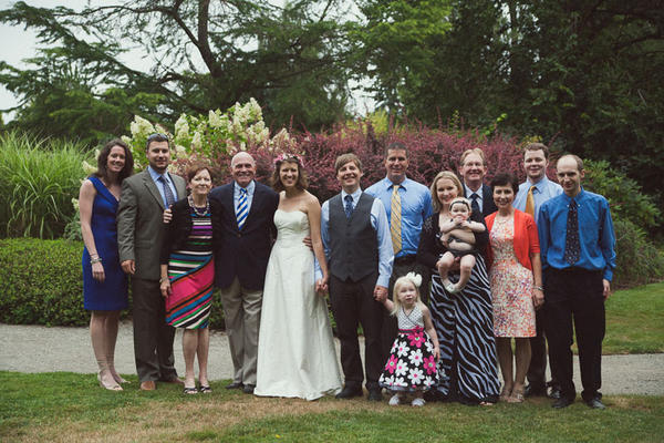 Liz Mattson and her husband Mike Hodapp with their families on their wedding day on August 18, 2012.