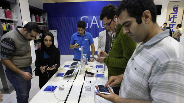 Customers try out cellphones and tablets in a store in Tehran, in 2012. Financial sanctions make it difficult for U.S. firms to do business in Iran, analysts say.