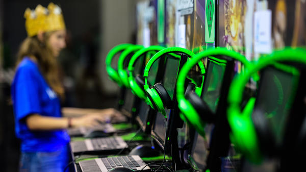 An attendee plays video games at the Gamescom 2015 gaming trade fair on August 5, 2015 in Cologne, Germany.
