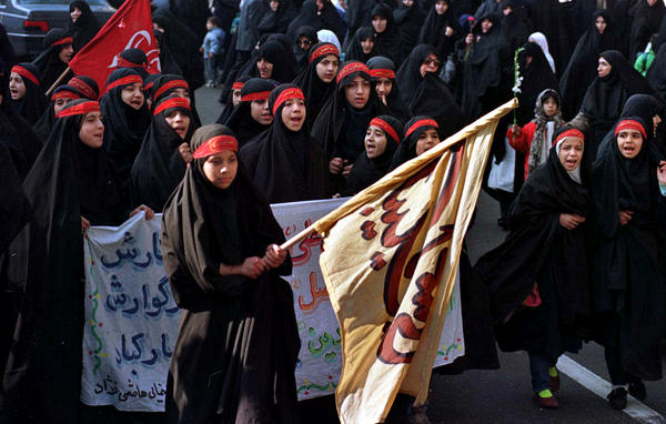 """Iranian women shout anti-American slogans after Friday prayers at the Tehran University mosque in 1997. Crowds gather every Friday after the prayers and often chant """"Death to America"""" at the university — not far from the place where Iran has a nuclear research reactor provided by the U.S. in the 1960s."""