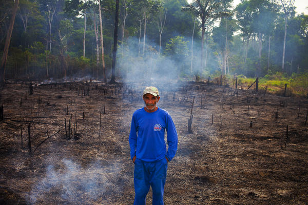 This caretaker of a small farm outside Porto Velho says he is burning his boss's land to make it better for the cattle.