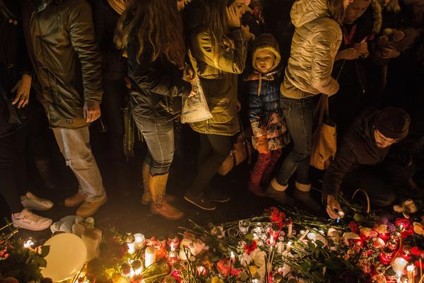 People mourn the victims of the Airbus A321 crash at the Palace Square on Sunday in St. Petersburg, Russia.