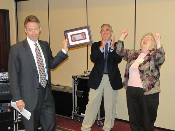 Matt McCormick and Scott Samuelson thank Susan Leckband for six years as chair of the Hanford Advisory Board in 2012.