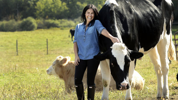 "Tracey Stewart poses with Tweed and Gidget at Farm Sanctuary's Watkins Glen, N.Y., location. Stewart is the founder of the online magazine, <a href=""http://moomah.com/themagazine"">Moomah</a><em>.</em>"