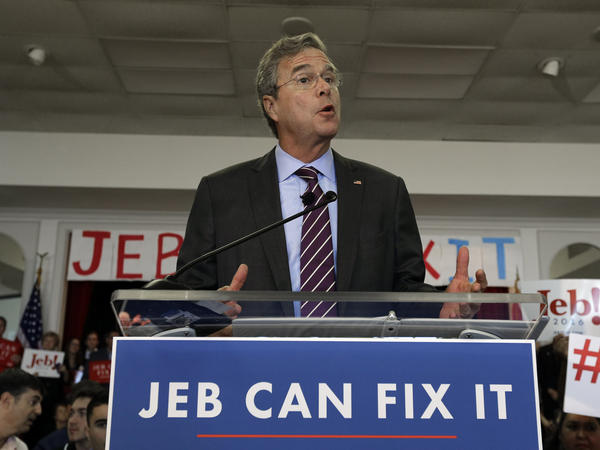 Republican presidential hopeful Jeb Bush speaks during a rally Monday in Tampa, Fla. He owns his new slogan, but jebcanfixit.com belongs to someone else.