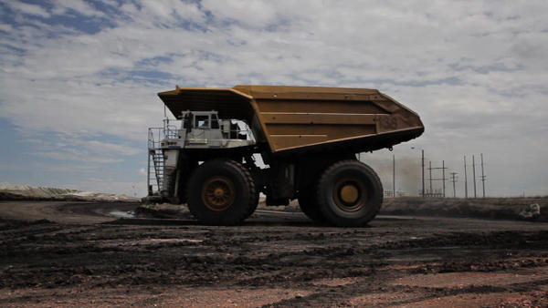 File photo of a truck at a Wyoming coal mine. Ashland has become the second Oregon city to formally come out against the investment of its dollars in coal and other fossil fuel industries.