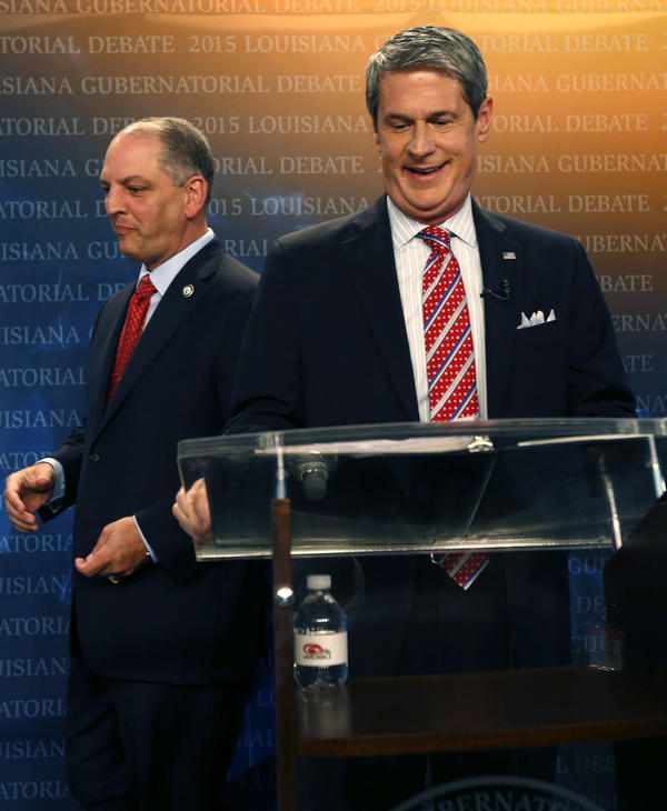 Louisiana Democratic state Rep. John Bel Edwards walks past Republican U.S. Sen. David Vitter as they take their places before a gubernatorial debate.