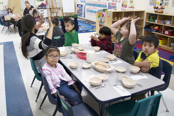 Students at the Head Start in Noel, Missouri, eat breakfast together every morning before their school day begins.