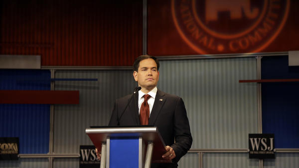 Marco Rubio stands alone during a Republican presidential debate in Milwaukee on Tuesday. He spoke to NPR about a hot-button issue in that debate — immigration.