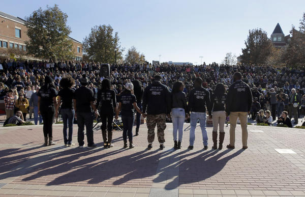 Members of black student protest group Concerned Student 1950 hold hands following the announcement that University of Missouri System President Tim Wolfe would resign Monday, Nov. 9, 2015, at the university in Columbia, Mo. Wolfe resigned Monday with the football team and others on campus in open revolt over his handling of racial tensions at the school. (Jeff Roberson/AP)