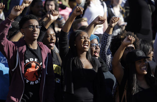 Students cheer while listening to protesters, following the announcement that Tim Wolfe, the president of the University of Missouri System, would resign.