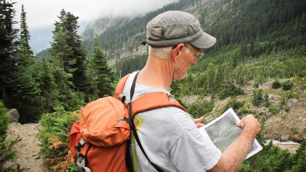 Dan Miller, a geomorphologist, hikes to a potential debris field in the North Cascades to look for signs in the landscape of landslides.