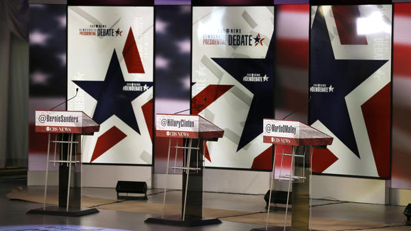 The podiums are seen on the stage during final preparations for Saturday night's Democratic presidential debate between Sen. Bernie Sanders, I-Vt., Hillary Rodham Clinton and former Maryland Gov. Martin O'Malley, in Des Moines, Iowa.