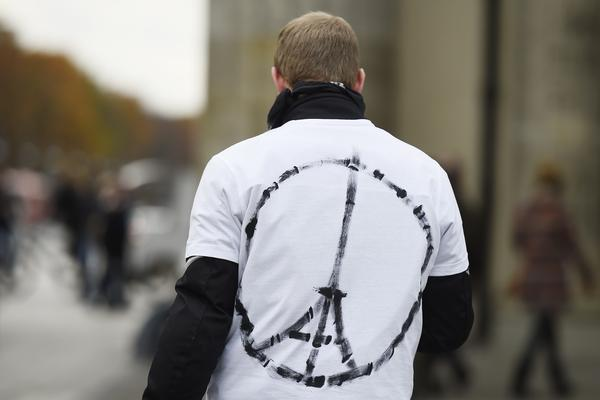 """A man wears a shirt with the """"Peace for Paris"""" symbol, near the French Embassy in Berlin on Saturday, a day after the deadly attacks in Paris."""