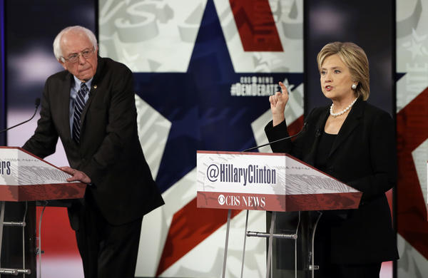 Hillary Rodham Clinton makes a point as Bernie Sanders listens during a Democratic presidential primary debate on Saturday in Des Moines, Iowa.