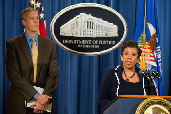 Attorney General Loretta Lynch, accompanied by Education Secretary Arne Duncan, announces the $95.5 million settlement with Education Management Corp.